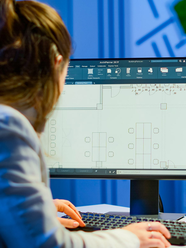 Over the shoulder shot of engineer working with architectural plans